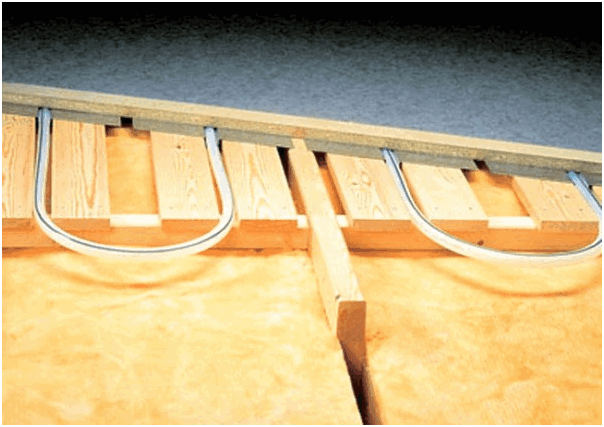 Как уложить тёплый пол по деревянным лагам?